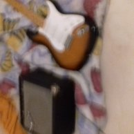 Fender electric guitar with amplifier that has been barely used
