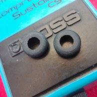 Set of two battery lid rubber grommets for Boss pedals.